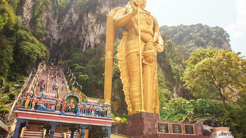 Camera Goes along Steps to Entrance Top of Batu Caves Footage