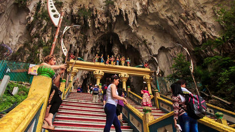 Camera Shows City from Behind Murugan Statue in Batu Caves Footage