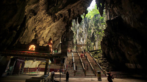 People Walk around Large Square Inside Batu Caves Footage