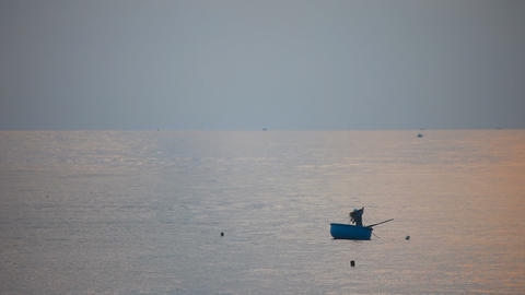 Fisherman on a round boat out to sea Footage