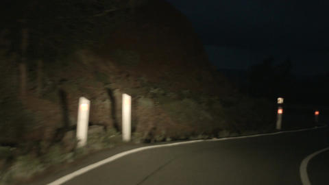 Drunk driving at night on serpentine mountain road, risk of accident, danger Live Action