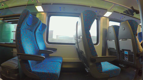 Economy class train with many empty seats moving, no passengers travel, crisis Footage