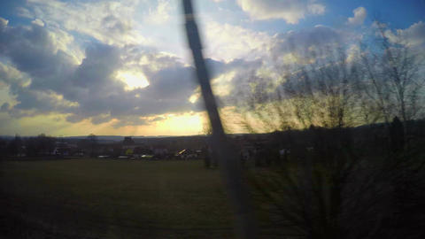 Time-lapse view through window of high speed train passing towns, stations Footage