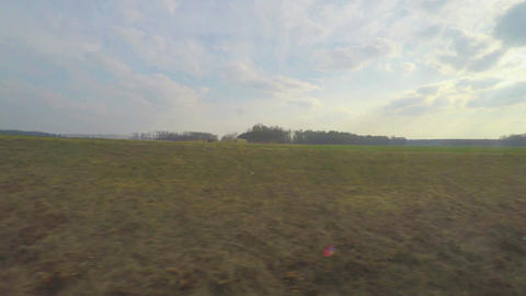 Train passing vast farming fields, plants, industrial area, view through window Footage