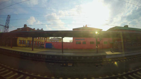 Passenger train passing railway station, arrival at destination, industrial view Footage