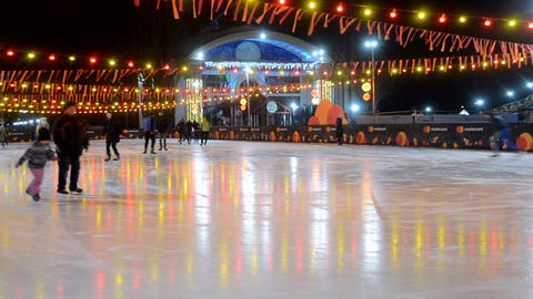 People ride on an ice rink Live Action