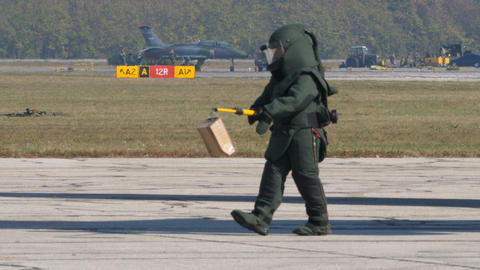 Bomb Disposal Expert with Anti Explosions Suite Transport a Bomb Live Action