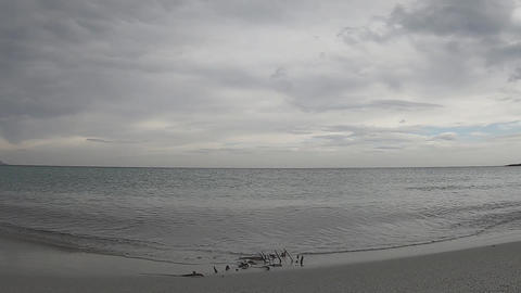 Suggestive time lapse of the sea almost flat with the cloudy gray sky in flat color Live Action