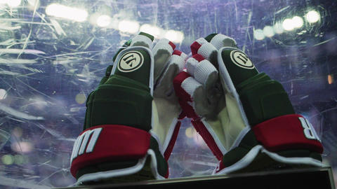 hockey player protective gloves on transparent shield Live Action