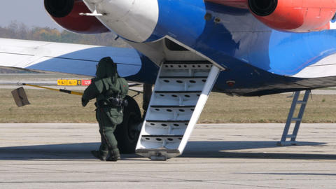 Bomb Disposal Expert with Anti Explosions Suite Transport a Bomb from a Airplane Live Action