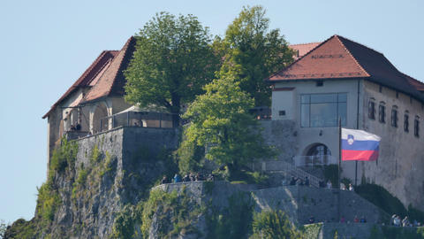 Medioeval Famous Castle in the Mountain over the Bled Lake in Slovenia 4K UHD Live Action