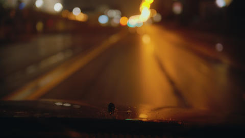 Driving a car at wet rainy night - splash onto the windshield Live Action