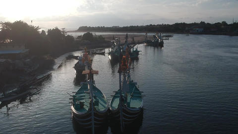 many traditional Balinese boats on the background of the harbor and the river Live Action