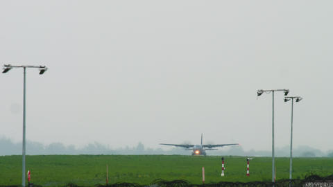 Military transport aircraft landing at rainy weather Live Action