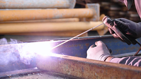 Welding work, Man Welding in Workshop. Metalwork and Sparks. Construction an Live Action