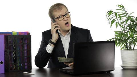 Businessman manager holding bunch of money paper banknotes making telephone call Live Action