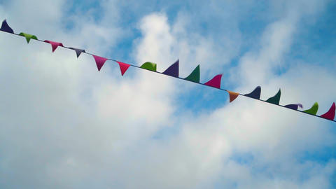 Small triangular waving flags. Colorful triangular flags waving in the wind Live Action