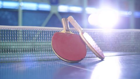 Table tennis paddles and jumping balls Live Action
