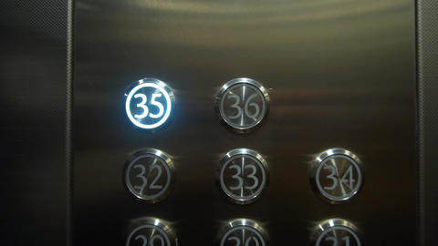 Buttons in the elevator. The button in the elevator to the thirty-fifth floor is Live Action