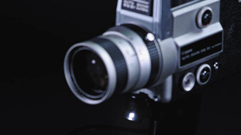 Super 8 camera in front of a black background Live Action