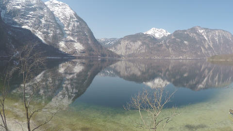 Amazing view of snowy Austrian Alps reflection in water, beautiful national park Live Action