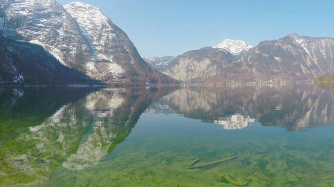 Beautiful snowy Alps, reflection of mountains in crystal clear water, nature Footage