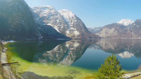 Amazing mountain landscape for recreation, blue sky, reflection in water surface Footage