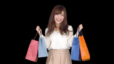 Young Japanese woman shopping with colorful bag 4 Live Action