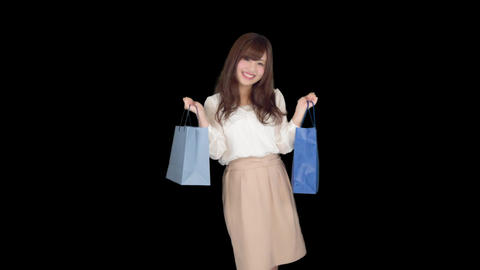 Young Japanese woman shopping with colorful bag 5 Bild