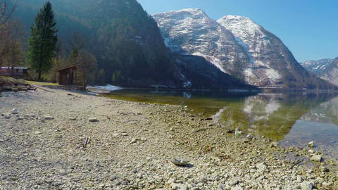 Beautiful stony lakeside in Austrian Alps, mountain lake, low season at resort Footage