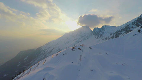 Majestic mountain range, snow groomer cleaning skiing run, extreme sport, resort Footage