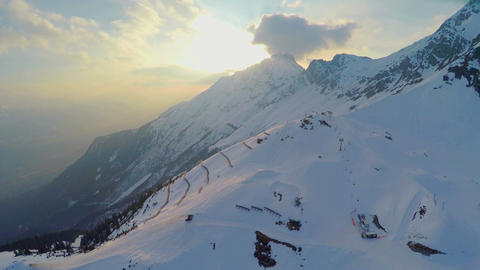 Aerial view of popular ski resort in Alps, mountains covered with snow, cableway Footage