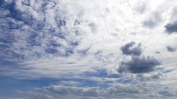Cloudscape time-lapse 4k nature video: rolling cumulus clouds moving on blue sky Footage