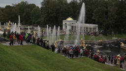 Group of tourists visiting the Grand Palace in Peterhof St.Petersburg, Russia Footage