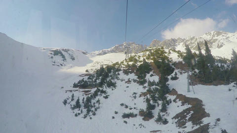 Real time view from cablecar cabin moving over snowy... Stock Video Footage