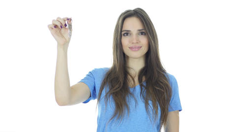Beautiful Woman Showing Keys of House, White Background Footage