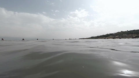 Low angle view toward the beach from water level at Dead Sea Footage
