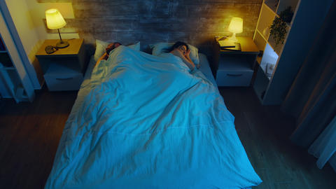 Top view of young couple sleeping Live Action