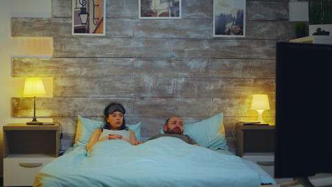 Tired couple in their bedroom going to sleep Live Action
