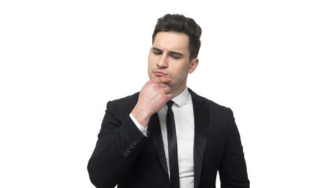 Young business man thoughtful thinking about project or idea isolated over white Live Action