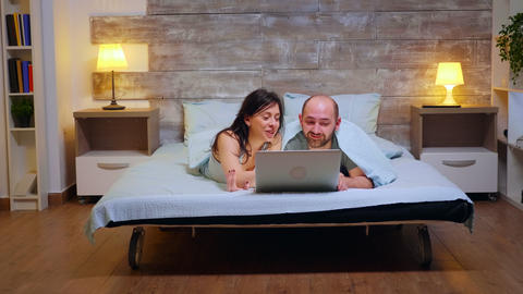 Zoom in shot of couple wearing pajamas Live Action