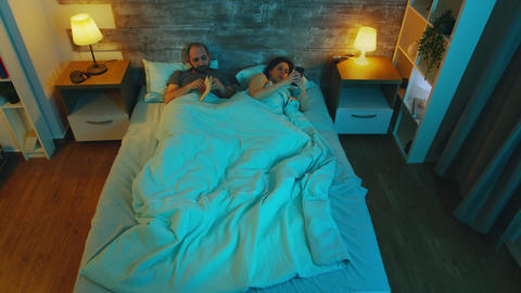 Top view of couple in their bedroom late at night Live Action