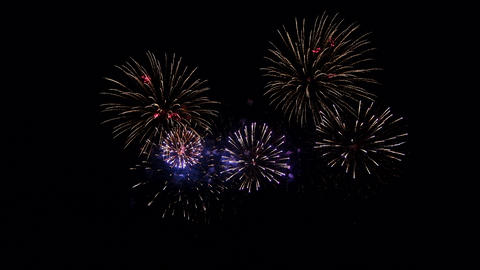 Colourful Fireworks in night sky, black isolated background Live Action