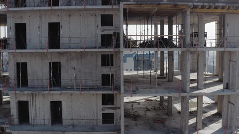 The process of building a new modern multi-storey building in the city in the Live Action