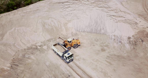 The work of loading equipment in the sand quarry Live Action