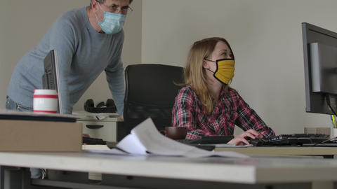 Side view of concentrated Caucasian woman in face mask searching information in Live Action