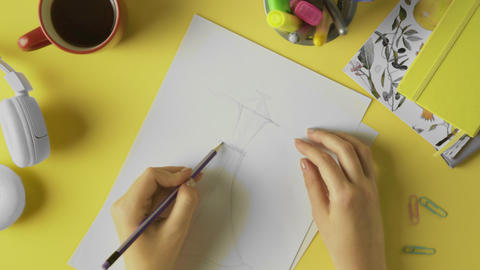 Fashion designer drawing clothes sketch Live Action