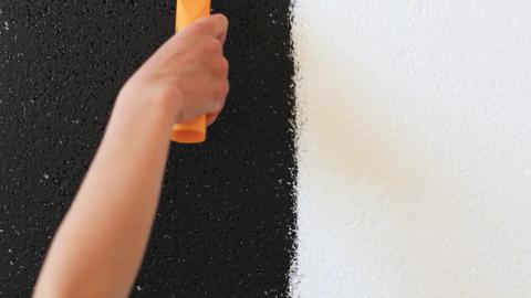 Hand paints foam polystyrene black Live Action