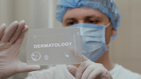 Doctor uses tablet with text Dermatology Live影片
