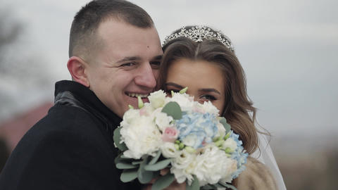 Newlyweds. Face portrait shot of lovely young caucasian groom and bride Live Action